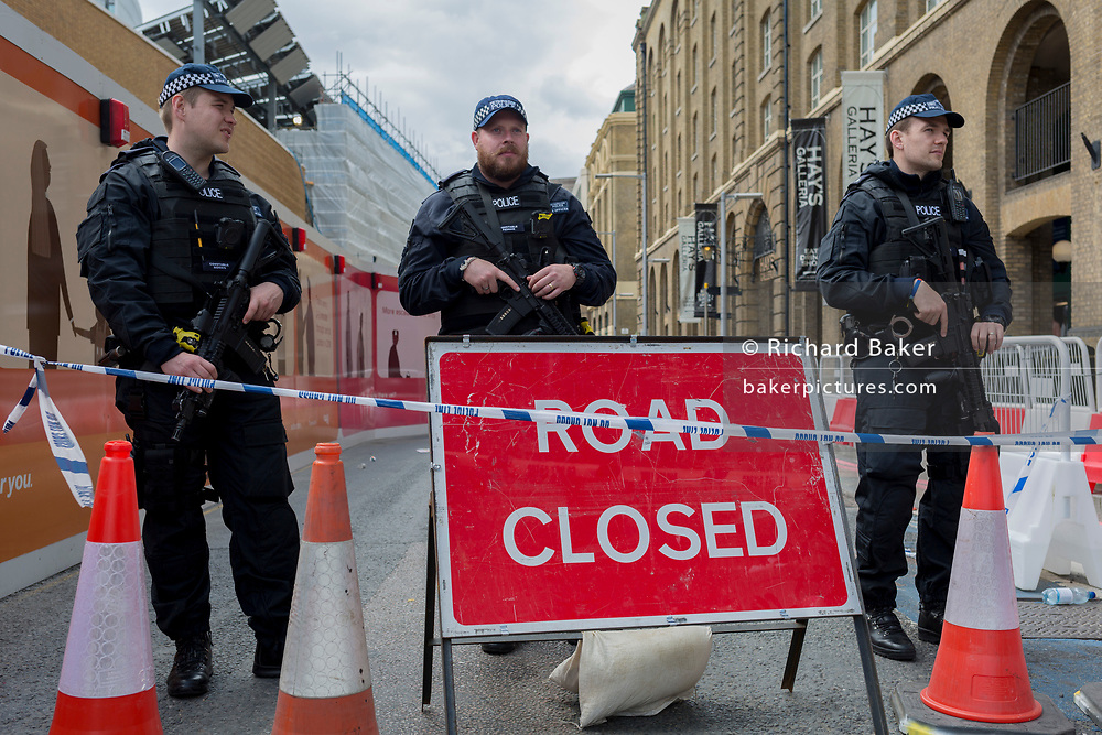 In the aftermath of the London Bridge and Borough Market terrorist attack the previous night, armed police are positioned at closed road junctions a half a mile from the crime scene where 7 people were killed and many others injured (Sunday's total). On Sunday 4th June 2017, in the south London borough of Southwark, England. (Photo by Richard Baker / In Pictures via Getty Images)