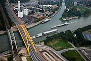 Nederland, Utrecht, Leidsche Rijn, 19-09-2009;.Hogeweidebrug, stalen boogbrug over het Amsterdam-Rijnkanaal vervangt de  Vleutensebrug. De spoorbrug links wacht op vervanging in verband met de spoorverdubbeling Utrecht - Harmelen. Verbinding tussen binnenstad Utrecht en Leidsche Rijn.Aan de andere kant van het kanaal de koffiefabriek van Douwe Egbert, tevens vestiging hoofdkantoor Sara Lee Corporation..Hogeweide Bridge, steel arch bridge over the Amsterdam-Rhine canal bridge replaces the Vleutense brug. The railway bridge at the awaits broadening related to the track doubling Utrecht - Harmelen. On the other side of the canal the Douwe Egbert coffee plant, also headquarters Sara Lee Corporation.luchtfoto (toeslag), aerial photo (additional fee required).foto/photo Siebe Swart