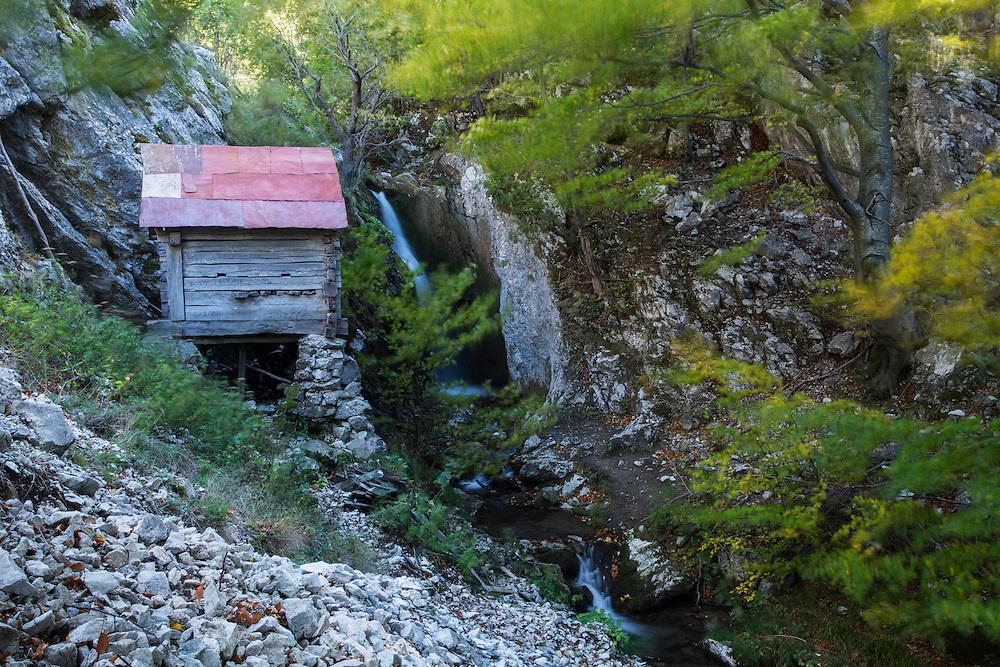 "Old mill (locally called ""Moara Dracului"", ""Devil's Mill"") used by shepherds to grind corn to produce traditional ""Mămăligă"" bread / cake. Domogled Valea Cernei National Park, Baile Herculane, Caras Severin, Romania."