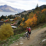 Reon Boe in action as mountain bike racers tackle the Ben Lomond Forest course high above Queenstown during the Outside Sports Super D Enduro event in Queenstown, Central Otago, at the Weekend. The 6 hour non stop team and individual races attracted 86 competitors and included Skyline Gondola access.  The Open Female category was won by Hanna Thorne from Dunedin while Kurt Lancaster from Nelson won the Open Male Category. The event was part of the inaugural Queenstown Bike Festival, taking place from 16th-25th April. The event hopes to highlight Queenstown's growing profile as one of the three leading biking centres in the world. Queenstown, Central Otago, New Zealand. 16th April 2011. Photo Tim Clayton..