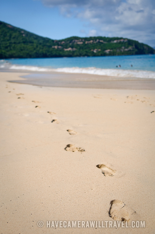 Footprints in the sand on the beach at Cinnamon Bay, St. John, in the US Virgin Islands. Shallow depth of field.