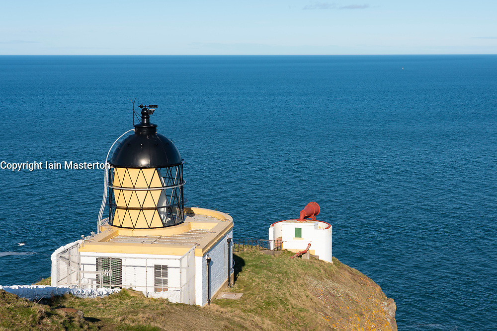 View of lighthouse at St Abbs Head in Scottish Borders, Scotland, UK