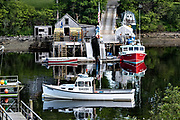 Lobster boats along the wharfs of New Harbor, Maine. The tiny picturesque pocket harbor is one of the last working harbors on the midcoast along the Pemaquid Peninsula