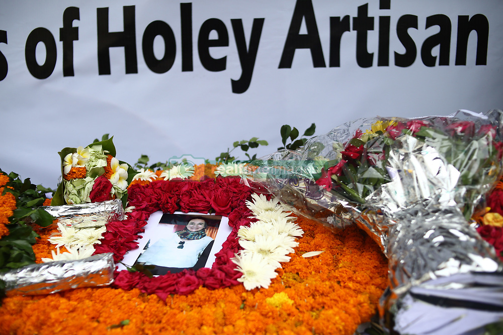 July 1, 2017 - Dhaka, Bangladesh - Wreaths for the Holey Artisan victims are laid at the site of the attack in Gulshan on its first anniversary. (Credit Image: © Sony Ramany/NurPhoto via ZUMA Press)