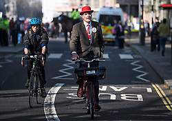 © Licensed to London News Pictures. 29/03/2019. London, UK. A Brexit supporter is seen riding his bike near Parliament square where March for Leave has completed it's final leg of a mass walk from Sunderland. MPs will later vote on the withdrawal agreement, which sets out the terms of the UK's departure from the EU. Photo credit: Ben Cawthra/LNP