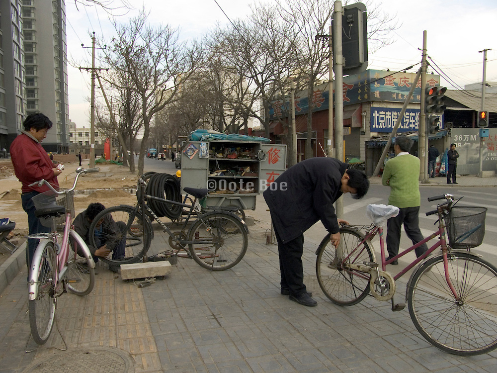a bicycle repair shop in the street Beijing China