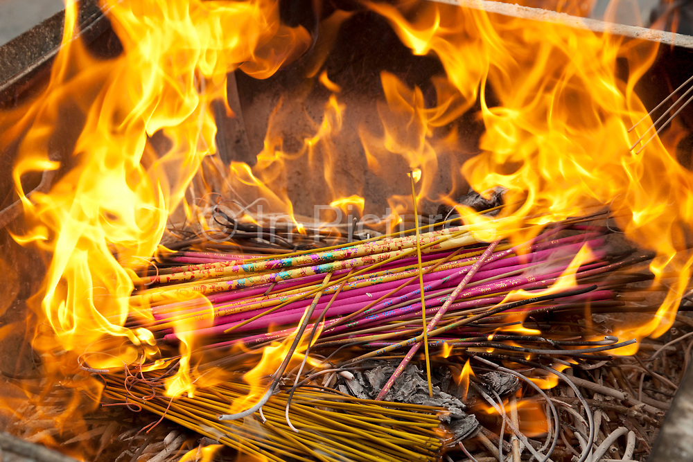 "Incense sticks burning at Yonghe Temple, also known as the ""Palace of Peace and Harmony Lama Temple"", the ""Yonghe Lamasery"", or - popularly - the ""Lama Temple"" is a temple and monastery of the Geluk School of Tibetan Buddhism located in the northeastern part of Beijing, China. It is one of the largest and most important Tibetan Buddhist monasteries in the world. The building and the artworks of the temple is a combination of Han Chinese and Tibetan styles."