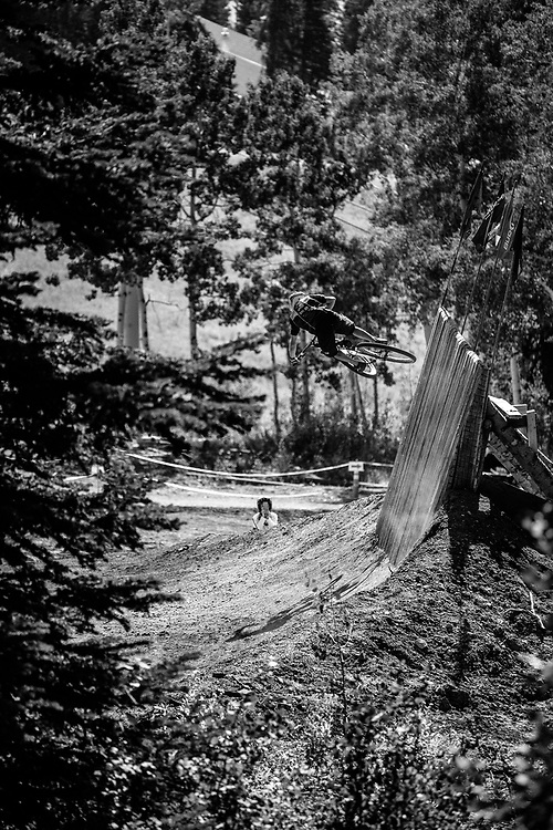 An unknown rider gets air off one of the features in bike skills area of Grand Targhee Resort, Wyoming.
