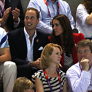 Royals Kate Middleton and Prince William, the Duke and Duchess of Cambridge at the swimming finals at the Aquatic Centre at Olympic Park,  during the London 2012 Olympic games. London, UK. 3rd August 2012. Photo Tim Clayton