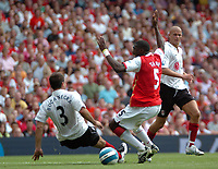 Photo: Tony Oudot. <br /> Arsenal v Fulham. Barclays Premiership. 12/08/2007. <br /> Kolo Toure of Arsenal is brought down by Carlos Bocanegra of Fulham and and is awarded a penalty