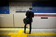 Japan - Tokyo - A salaryman wait for the train in Oedo line - Composition remain the painting of Mondrian - 2012