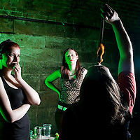 Picture shows :  Writer Ailsa Longmuir  (in black) learns the Art of Fire Breathing / Fire Eating with her first  lesson from the Purple Productions team of Rufus T. Fahrenheit (eating fire) and Lucille Burn (animal print)....Picture Drew Farrell Tel : 07721-735041.
