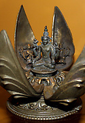Vishnu in the lotus, bronze, eastern India, 1100-1200. Vishnu sits holding a lotus and other attributes at the centre of a movable lotus with eight hinged petals (seven survive). Each petal bears an image of one of his incarnations.