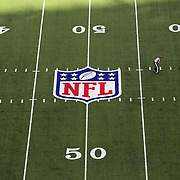 A general view of a referee on the field showing the NFL logo and field markings during the New York Jets V New England Patriots NFL regular season game at MetLife Stadium, East Rutherford, NJ, USA. 20th October 2013. Photo Tim Clayton
