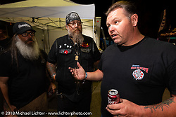 Roadside Marty Davis puts his points out to Mark Persichetti and Milwaukee Mike at Bling's Cycle party during the 78th annual Sturgis Motorcycle Rally. Sturgis, SD. USA. Tuesday August 7, 2018. Photography ©2018 Michael Lichter.