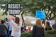 Protestors stand outside while Rep. Pete Sessions speaks during a town hall event at Richardson High School in Richardson, Texas on March 18, 2017. (Cooper Neill for The Texas Tribune)