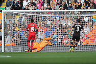 Sadio Mane of Liverpool shoots and scores his teams 3rd goal. Premier League match, Liverpool v Hull City at the Anfield stadium in Liverpool, Merseyside on Saturday 24th September 2016.<br /> pic by Chris Stading, Andrew Orchard sports photography.