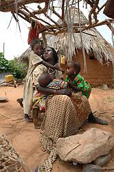 Aifa Aifa's sister, Fulul, sits with her children in her village of Gulul, near Barentu, Eritrea.    (Photo by Ami Vitale)