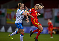 NEWPORT, WALES - Thursday, October 22, 2020: Wales' Gemma Evans (R) challenges for the ball with Faroe Islands' Ásla Johannesen (L) during the UEFA Women's Euro 2022 England Qualifying Round Group C match between Wales Women and Faroe Islands Women at Rodney Parade. Wales won 4-0. (Pic by David Rawcliffe/Propaganda)