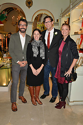 Left to right, PAUL VAN ZYL, REBECCA VAN BERGEN, CHRIS VAN BERGEN and KRISTY CAYLOR at the London debut of Nest - an organisation to promote peace and prosperity in partnership with artisans worldwide, held at Thomas Goode & Co, South Audley Street, London on 4th November 2014.