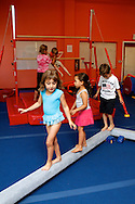Students walk a beam at The Little Gym in Brentwood on Saturday, May 19, 2012.  (Photo by Kevin Bartram)