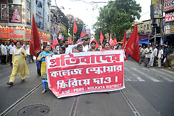 June 12, 2017 - Kolkata, West Bengal, India - Communist Party of India's women, student and youth wings protest against the state government decision to ban rallies and protest at College Square on June 12, 2017 in Kolkata. (Credit Image: © Saikat Paul/Pacific Press via ZUMA Wire)