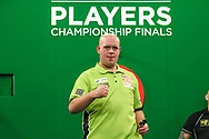 Michael van Gerwen beats Paul Nicholson in the first round and celebrates during the PDC Darts Players Championship at  at Butlins Minehead, Minehead, United Kingdom on 24 November 2017. Photo by Shane Healey.
