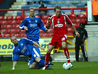 Photo: Chris Ratcliffe.<br />Leyton Orient v Boston United. Coca Cola League 2. 08/04/2006.<br />Paul Connor (R) of Leyton Orient is brought down by Alan White of Boston United to get a penalty which was scored to make it 2-0 to Leyton Orient