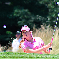 Paula Creamer watches the ball as she  hits out of a bunker on the sixth hole and saves par during the final round of the USGA 2010 U.S. Women's Open at Oakmont Country Club in Oakmont, Pennsylvania on July 11, 2010.   UPI/Archie Carpenter