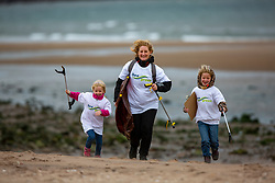 Lis Rolye with Alva (5) and Ida (3). SSE Renewables doing the beach clean in Carnoustie on Saturday morning.
