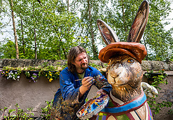 Chris Rutterford paints giant hare for Leuchie House Art Trail, Midlothian, Scotland, UK: <br /> Chris Rutterford, Scottish mural artist, best known recently for painting a mural in Colinton Tunnel, is helping Leuchie House celebrate its 10th anniversary by painting a giant fibreglass hare which, along with 9 other hares, will form a public art trail called The Big Hare Trail in North Berwick from July. The hare sculptures will be auctioned to raise money for the cahrity which offers respite for people living with neurological disorders.<br /> Sally Anderson | EdinburghElitemedia.co.uk