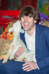 (c) Licensed to London News Pictures. 09/04/2014 London, UK. Alex James from Blur, hosts Farm Heroes Saga #BeAFarmHero pop-up farm event at Canary Wharf to celebrate the launch of the mobile game, which is now available.  credit Simon Ford/LNP