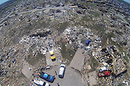 All the houses on a cul-de-sac in  the path of the May 20, 2013 tornado lie in ruins in Oklahoma City, Oklahoma May 22, 2013.  Rescue workers with sniffer dogs picked through the ruins on Wednesday to ensure no survivors remained buried after a deadly tornado left thousands homeless and trying to salvage what was left of their belongings. Curvature of horizon in the photo is due to an ultra-wide angle lens.  REUTERS/Rick Wilking (UNITED STATES)