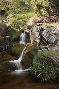 Series of small waterfalls on a stream flowing into the River Findhorn in Strathdearn.