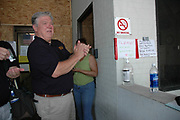 Haley Barbour, Governor of Misssissippi santizes his hand after visiting Bay St. Louis to pass out supplies Sunday Sept. 4,2005.(photo/Suzi Altman)