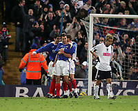 Photo: Lee Earle.<br /> Portsmouth v West Bromwich Albion. The Barclays Premiership. 17/12/2005. Portsmouth's Svetoslav Todorov (C) is congratulated as West Brom's Junichi Inamoto (R) looks dejected.