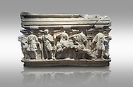 Roman sarcophagus with relief sculptures from Hierapolis . Hierapolis Archaeology Museum, Turkey<br /> <br /> Columned Sarcophagus Sarcopinagu of Euthios Pyrrnon, Asian Archon (ruler), Roman Period First quarter of third century A.D. Loadicea. <br />  <br /> Four sides of these sarcophagi are all in relief. They appear like a columned temple. The reliefs between the grooved columns are related to the private life of the individual. His/her education, heroic scenes and plant or mythological motifs are decorated in relief. The cover of the sarcophagus is arranged like a bed and it is depicted as the wife and the husband as lying on it. The name of the individual and some mythological reliefs are found in the surrounding of the cover. The two sarcophagi in the hall are of this kind. . Against a grey background .<br /> <br /> If you prefer to buy from our ALAMY STOCK LIBRARY page at https://www.alamy.com/portfolio/paul-williams-funkystock/greco-roman-sculptures.html- Type - Hierapolis - into LOWER SEARCH WITHIN GALLERY box - Refine search by adding a subject, place, background colour, museum etc.<br /> <br /> Visit our CLASSICAL WORLD HISTORIC SITES PHOTO COLLECTIONS for more photos to download or buy as wall art prints https://funkystock.photoshelter.com/gallery-collection/The-Romans-Art-Artefacts-Antiquities-Historic-Sites-Pictures-Images/C0000r2uLJJo9_s0c