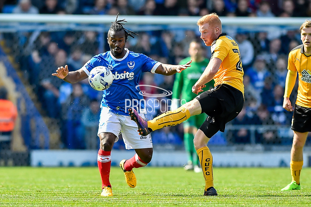 Portsmouth Midfielder, Stanley Aborah (29) and Cambridge United Midfielder, Conor Newton (24) during the EFL Sky Bet League 2 match between Portsmouth and Cambridge United at Fratton Park, Portsmouth, England on 22 April 2017. Photo by Adam Rivers.