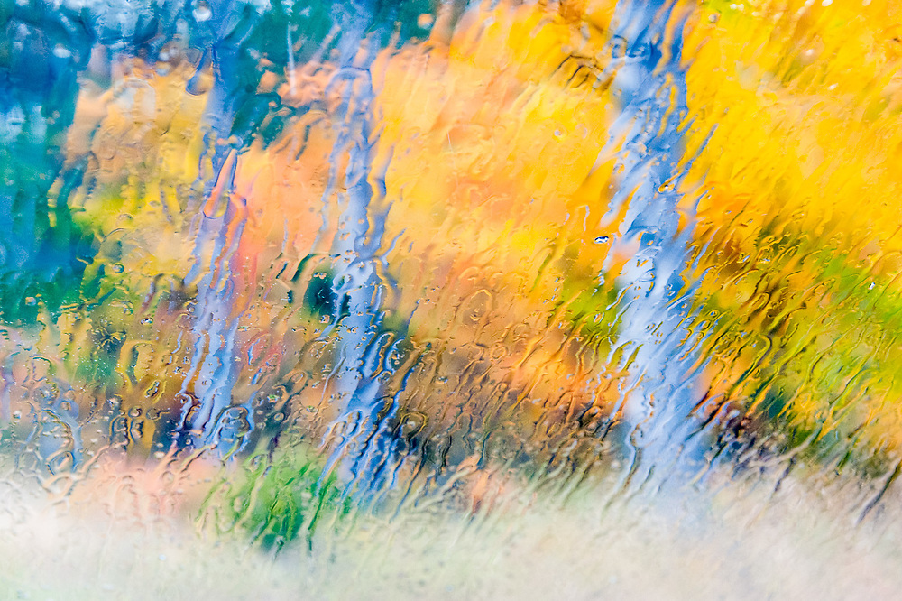 Along a country road, October, view through a wet windshield, Cheshire County, New Hampshire, USA