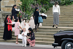 The bridal party and special attendants walk into the chapel for the wedding of Lady Gabriella Windsor and Mr Thomas Kingston at St George's Chapel in Windsor Castle.