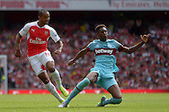 Reece Oxford of West Ham United  (r) challenges Theo Walcott of Arsenal. Barclays Premier League, Arsenal v West Ham Utd at the Emirates Stadium in London on Sunday 9th August 2015.<br /> pic by John Patrick Fletcher, Andrew Orchard sports photography.