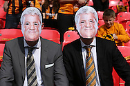 two fans in suits wear their face masks of Steve Bruce, the Hull City manager inside Wembley Stadium before k/o. Skybet football league Championship play off final match, Hull city v Sheffield Wednesday at Wembley Stadium in London on Saturday 28th May 2016.<br /> pic by John Patrick Fletcher, Andrew Orchard sports photography.
