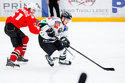 Anze Zupancic of Jesenice vs Eric Pance of Olimpija during ice hockey game between Team Jesenice and HDD Telemach Olimpija in 1st leg of Finals of Slovenian National Championship 2014, on March 31, 2014 in Arena Podmezakla, Jesenice, Slovenia. Photo by Vid Ponikvar / Sportida