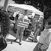 Despite a Trump campaign that advocates for building a wall between Mexico and the U.S. and deportation forces to round-up undocumented immigrants, volunteers for the Republican party solicit immigrants to vote outside the naturalization ceremony where over 6000 immigrants became new Americans.