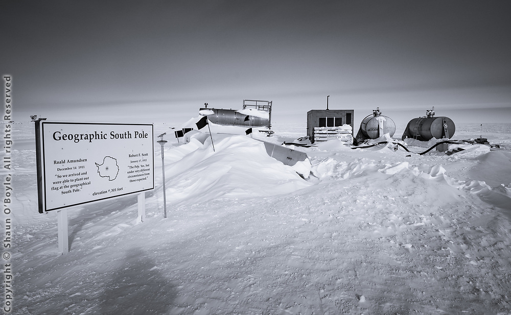 The geographic South Pole, southernmost point on earth, where every direction is North, where you can walk around that sign and walk through all 24 time zones,  the ultimate goal of early expeditions to Antarctica. With fuel tanks.