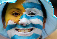 A female Uruguay fan with a painted face