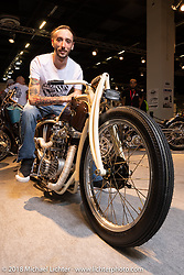 Racz Arpad Dorin with his 1973 Ironhead 1100 custom from Romania in the AMD World Championship of Custom Bike Building in the Intermot Customized hall during the Intermot International Motorcycle Fair. Cologne, Germany. Friday October 5, 2018. Photography ©2018 Michael Lichter.