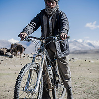 Give and take. One of our local Afghan support crew tries my bike, Wakhan Corridor, Afghanistan.