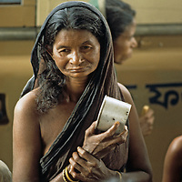 BANGLADESH, Dhaka. Impoverished Bengali mother waits for relief food ration at Mirpur destitute camp.