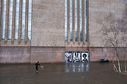 Scene at Tate Modern as two men use the location for exercise, with one playing tennis againts the wall, while another does some aerobic exercises as the national coronavirus lockdown three continues on 28th January 2021 in London, United Kingdom. Following the surge in cases over the Winter including a new UK variant of Covid-19, this nationwide lockdown advises all citizens to follow the message to stay at home, protect the NHS and save lives.